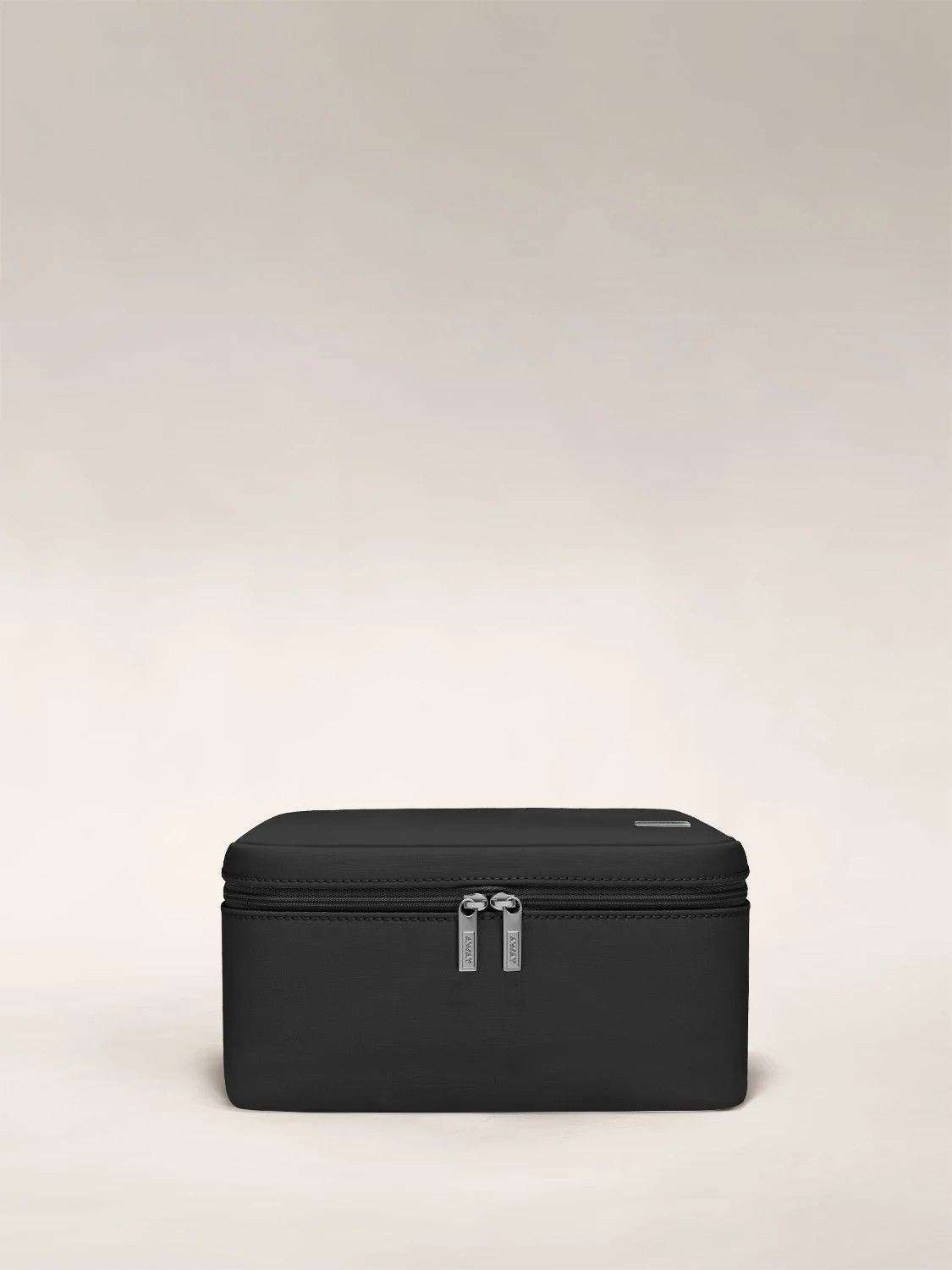 Front view of an Away black Cosmetics Bag in Nylon