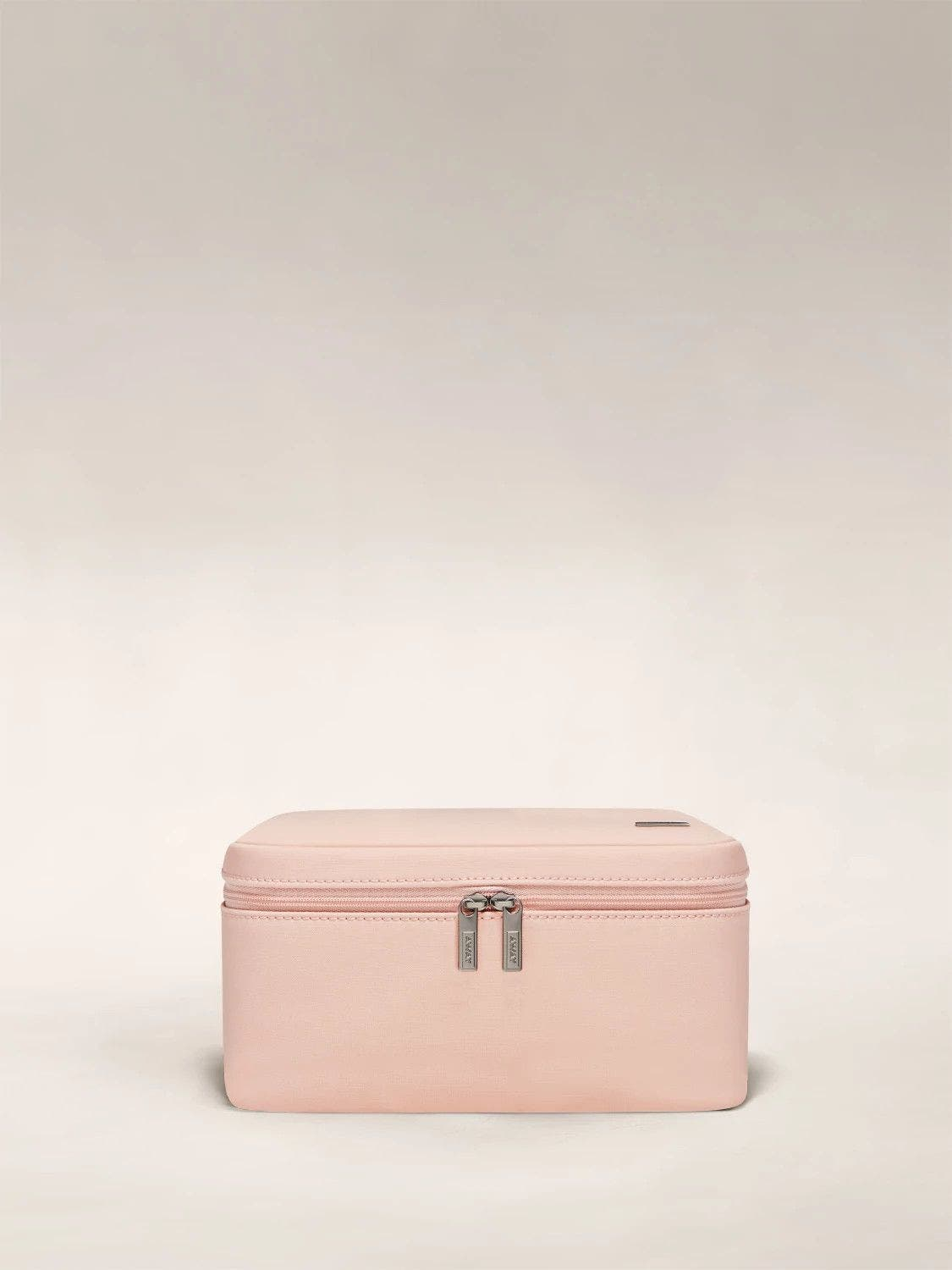 Front view of an Away petal pink Cosmetics Bag in Nylon