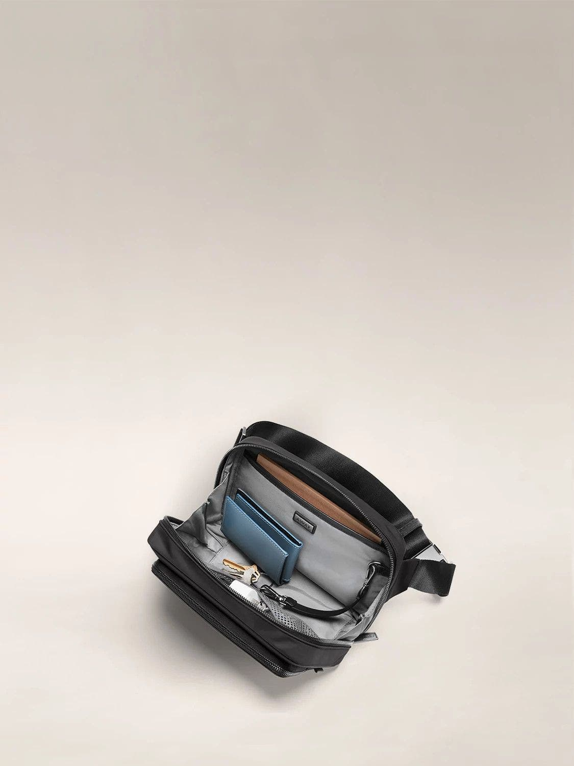 Interior view of the Away daily crossbody bag in the color black.