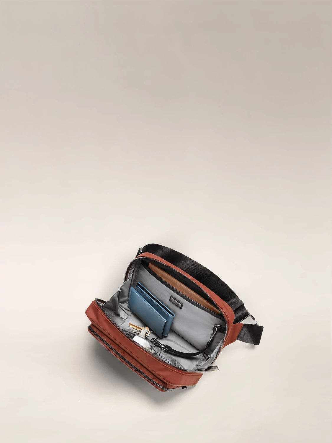 Interior view of the Away daily crossbody bag in the color brick.