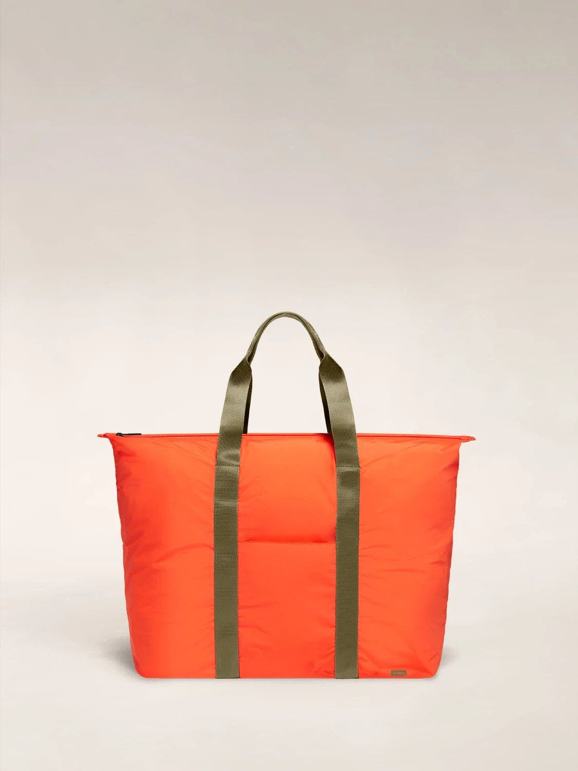 Front view of the Away packable carryall in the color cayenne.