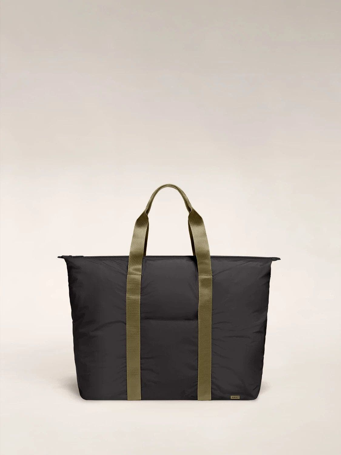Front view of the Away packable carryall in the color black.