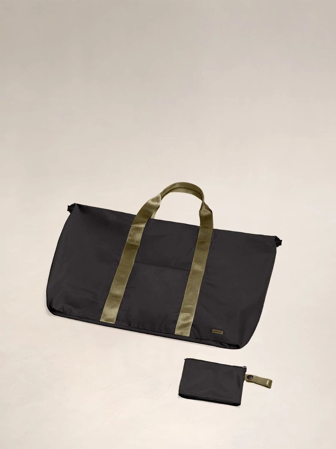 Flat view of the Away packable carryall in the color black.