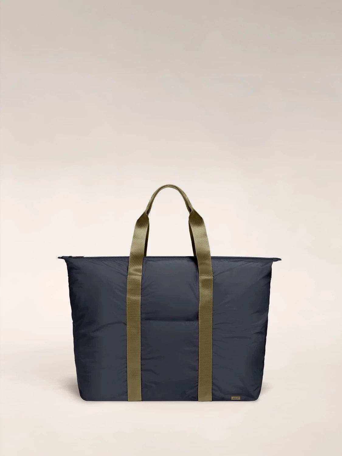 Front view of the Away packable carryall in the color navy.