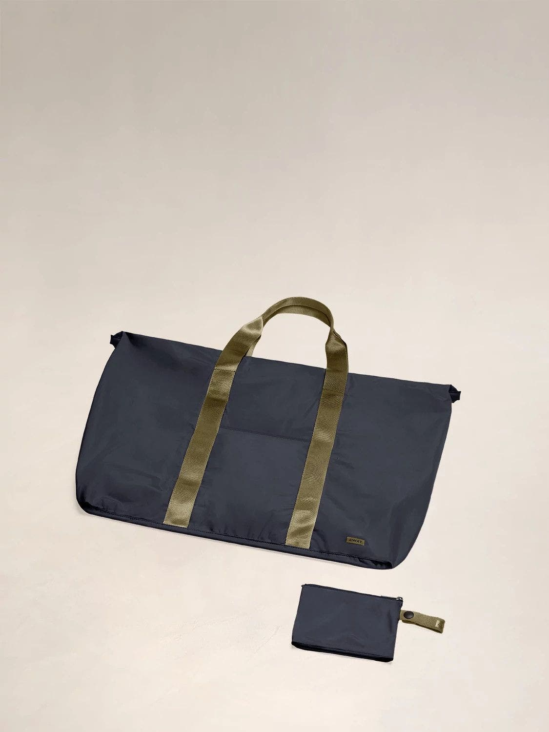 Flat view of the Away packable carryall in the color navy.