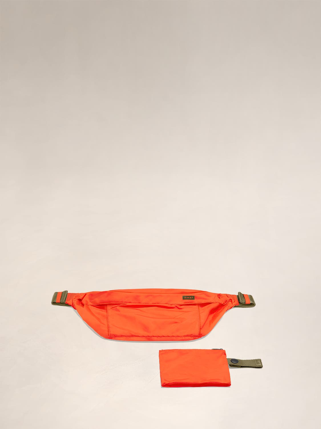 Flat view of the Away packable sling bag in the color cayenne.