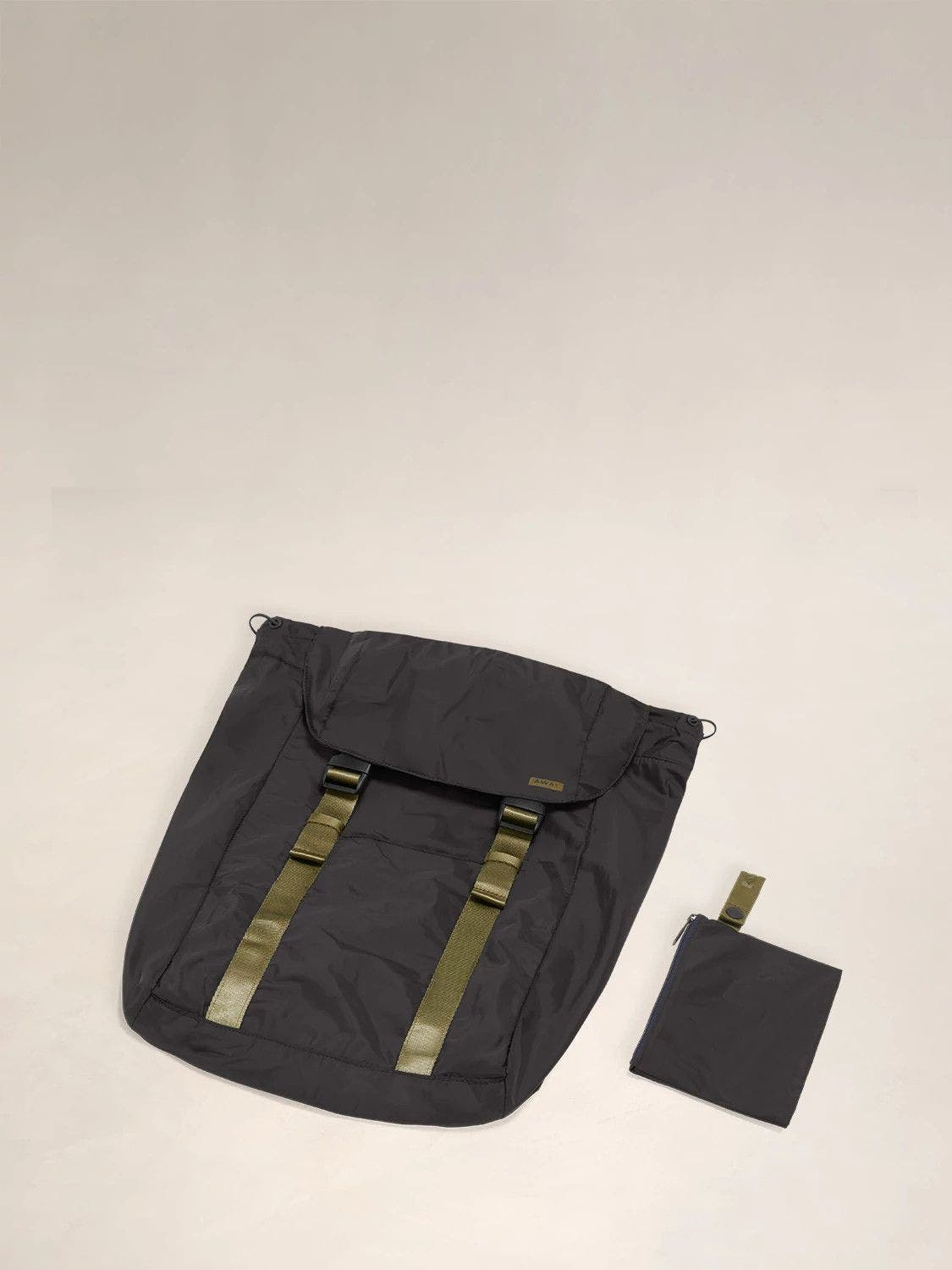 Flat view of the Away packable backpack in the color black.