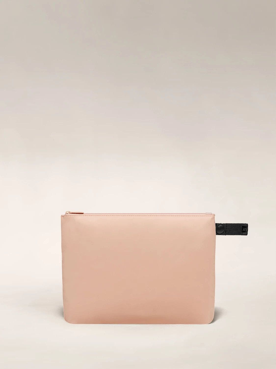 Front view of the Away large organizational travel pouch in the color petal pink