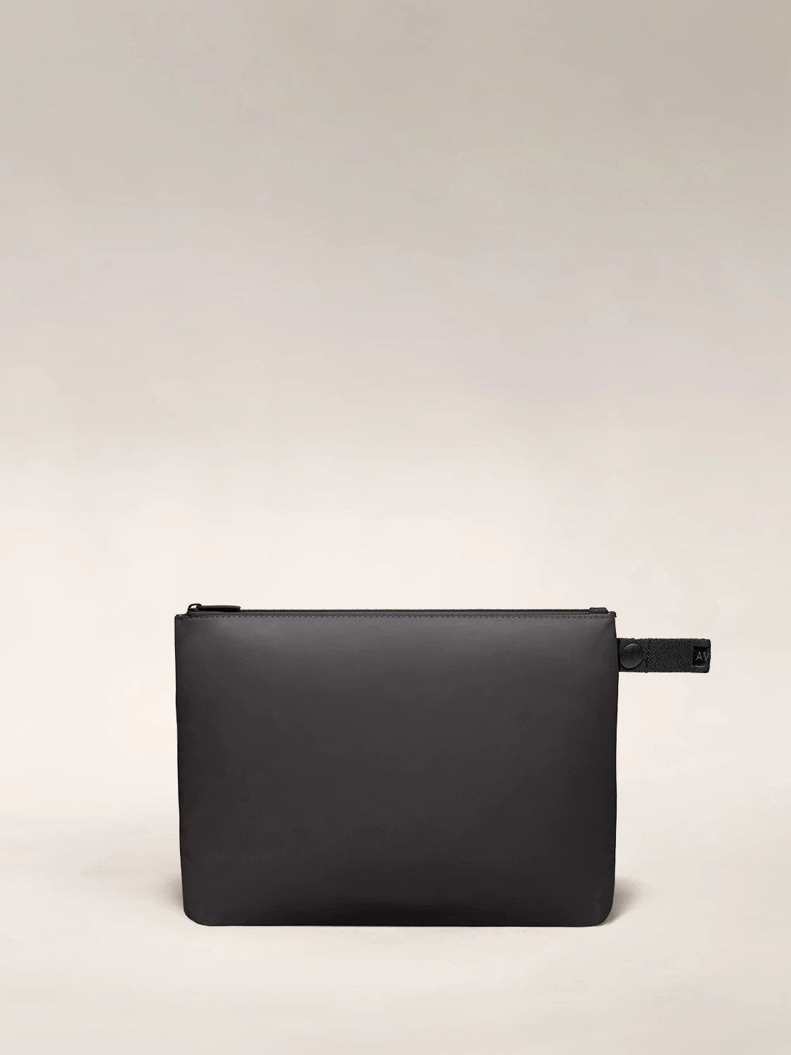Front view of the Away large organizational travel pouch in the color black