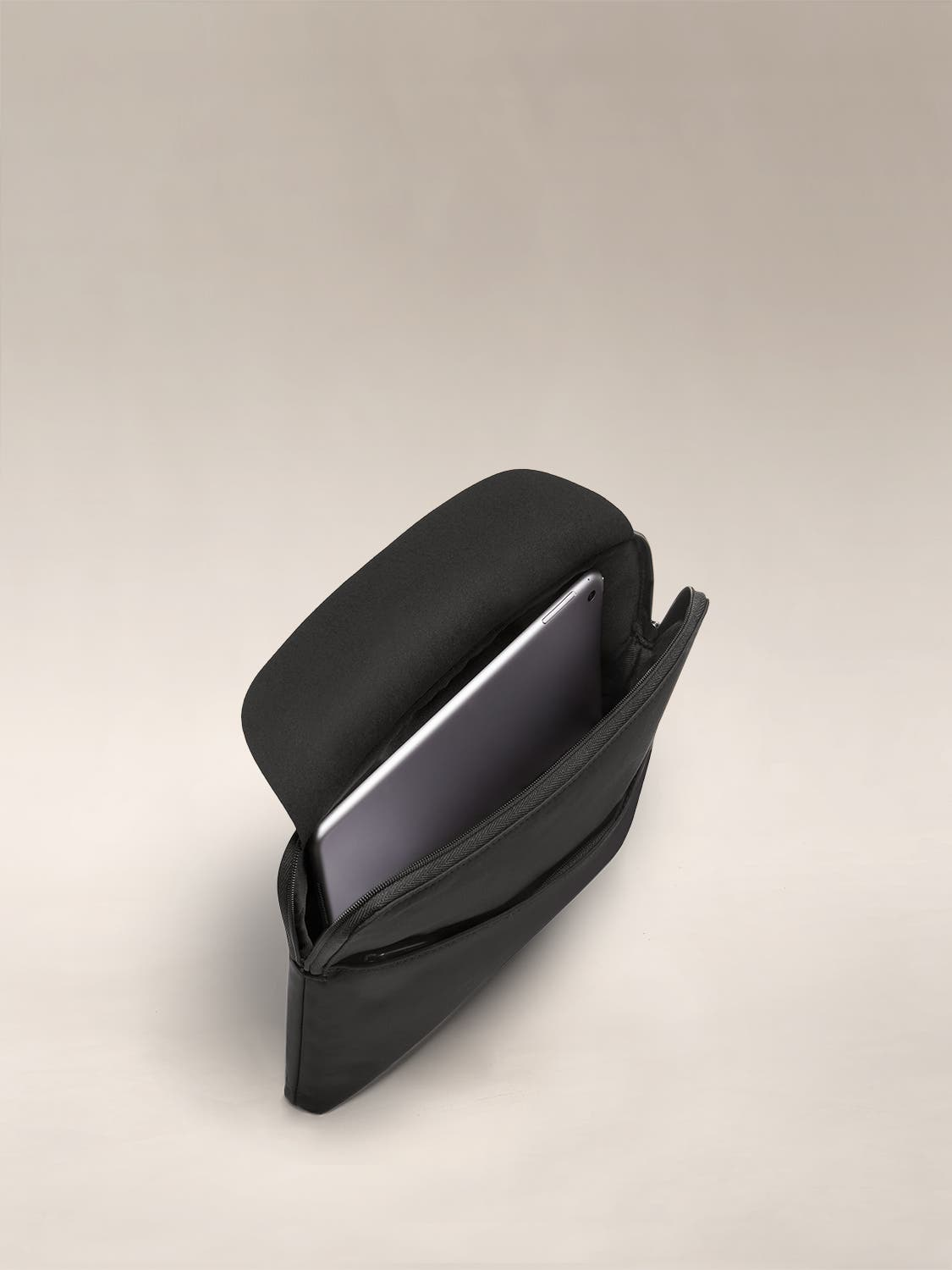 Open view of the Away Tablet Case in Black, with a laptop packed inside