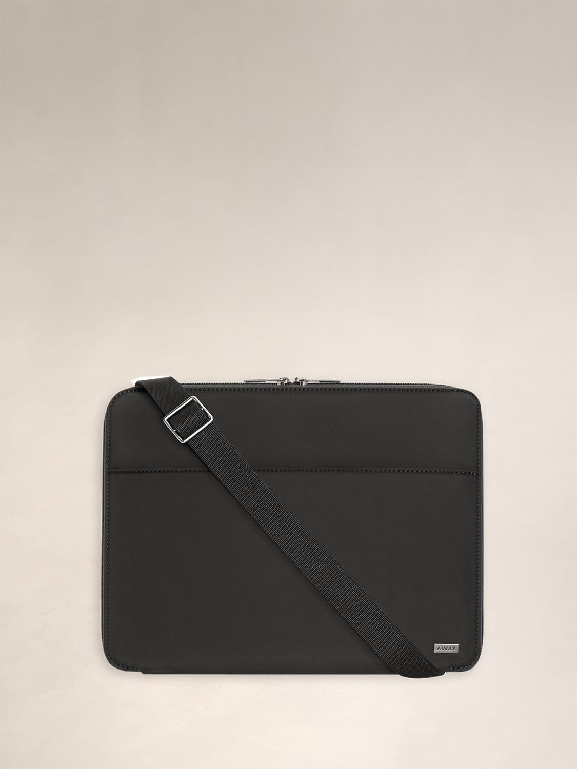 Front view of the Away Portfolio in the color black with a shoulder strap shown