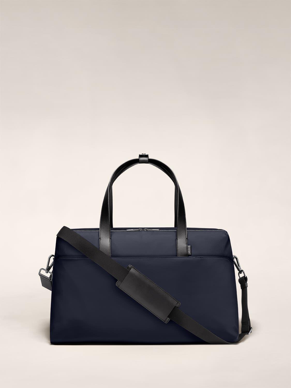 Large shoulder bag in navy with raised handles.