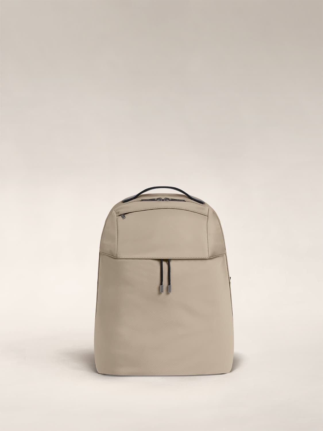 Front shot of a sand backpack with a front flap pocket.