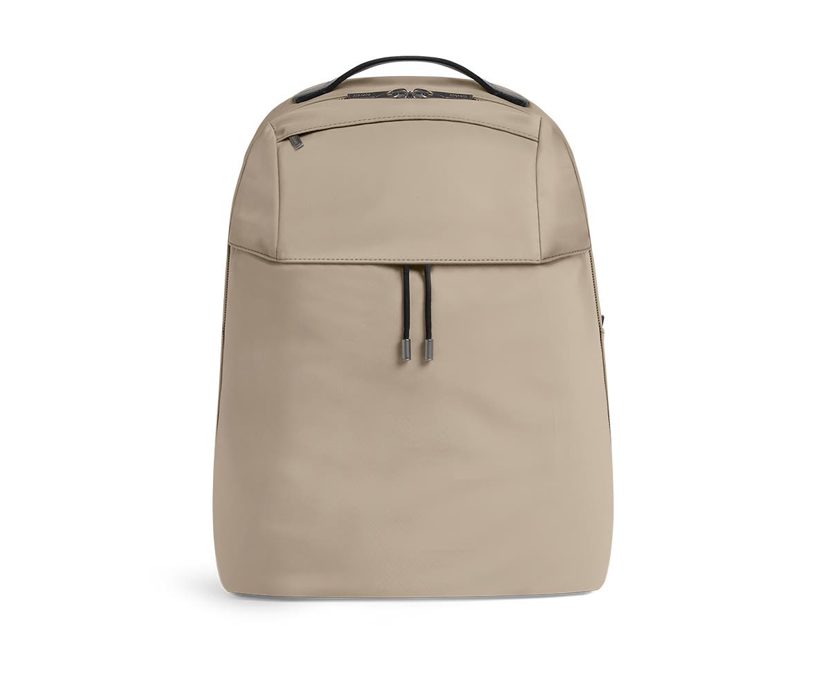 Front shot of sand backpack with a front flap pocket.