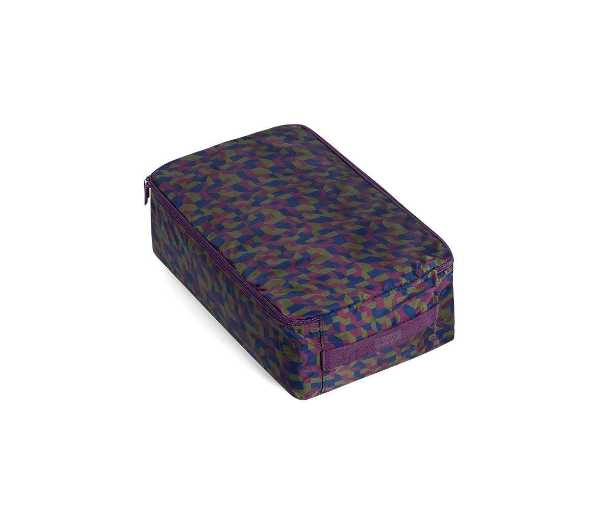 A large geometric print shoe cube