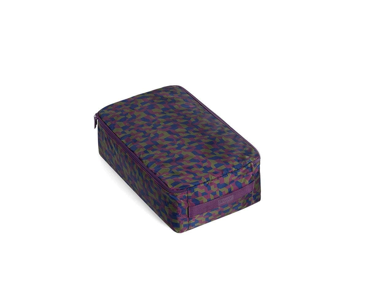 A angled view of a small geometric print shoe cube.