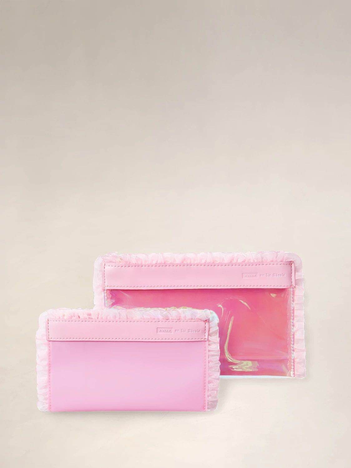 Two Travel Pouch Sets in pink with pink ruffle details.