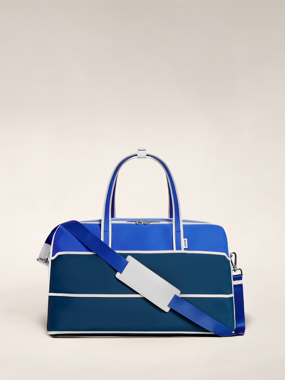 The Large Everywhere Bag by Ji Won Choi in blue geometric patterns and a shoulder strap