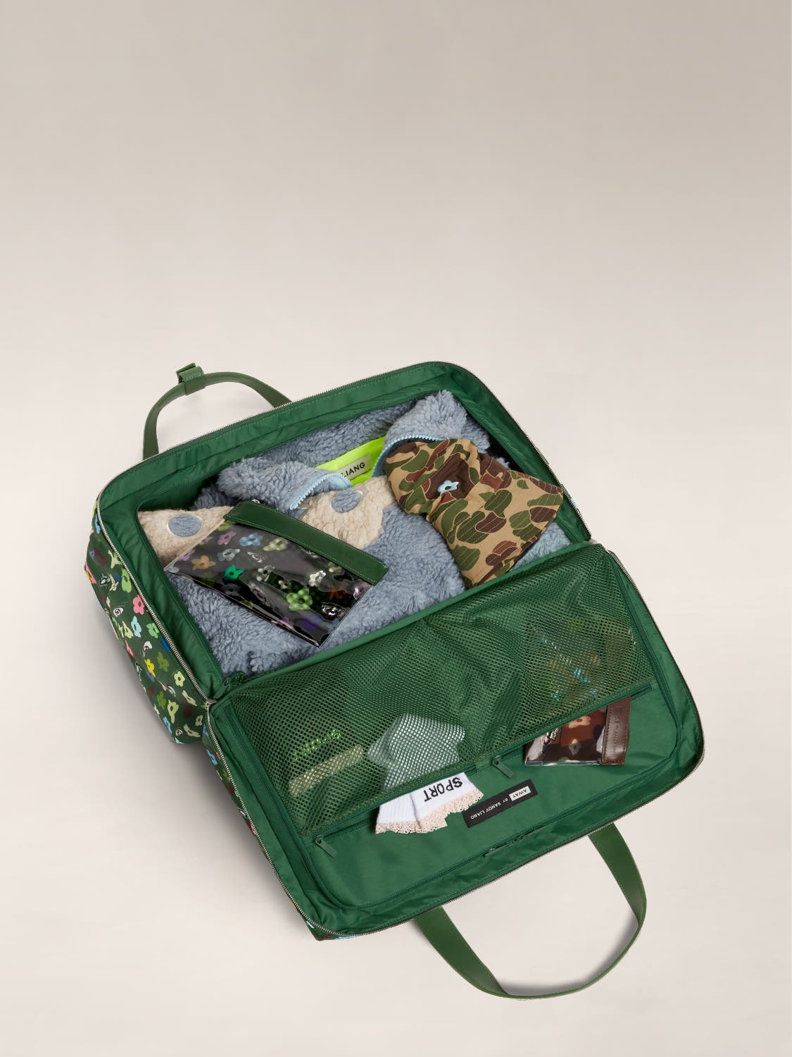 Open view of the Large Everywhere Bag by Sandy Liang with a green interior