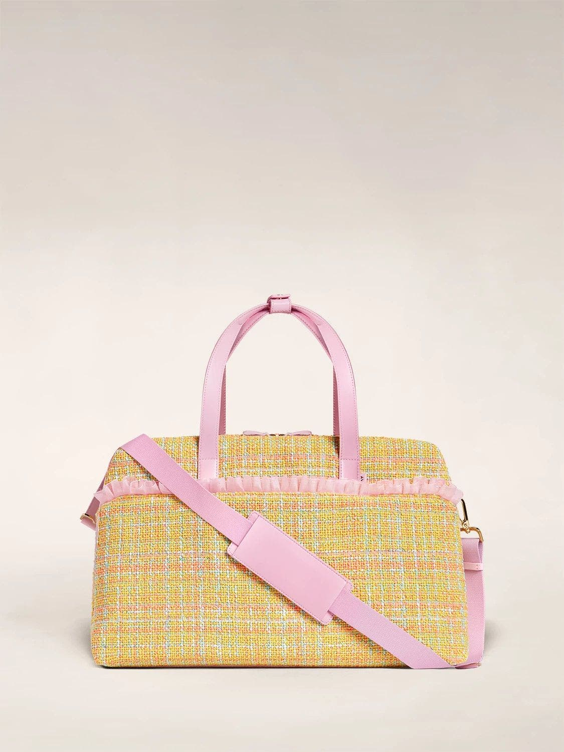 The Large Everywhere Bag by Tia Adeola in pink and yellow tweed with pink organza ruffle and a shoulder strap