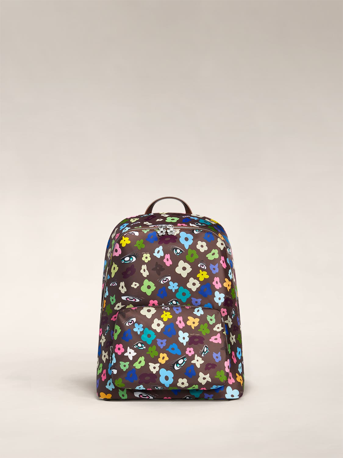 Front view of the Front Pocket Backpack by Sandy Liang in brown floral print