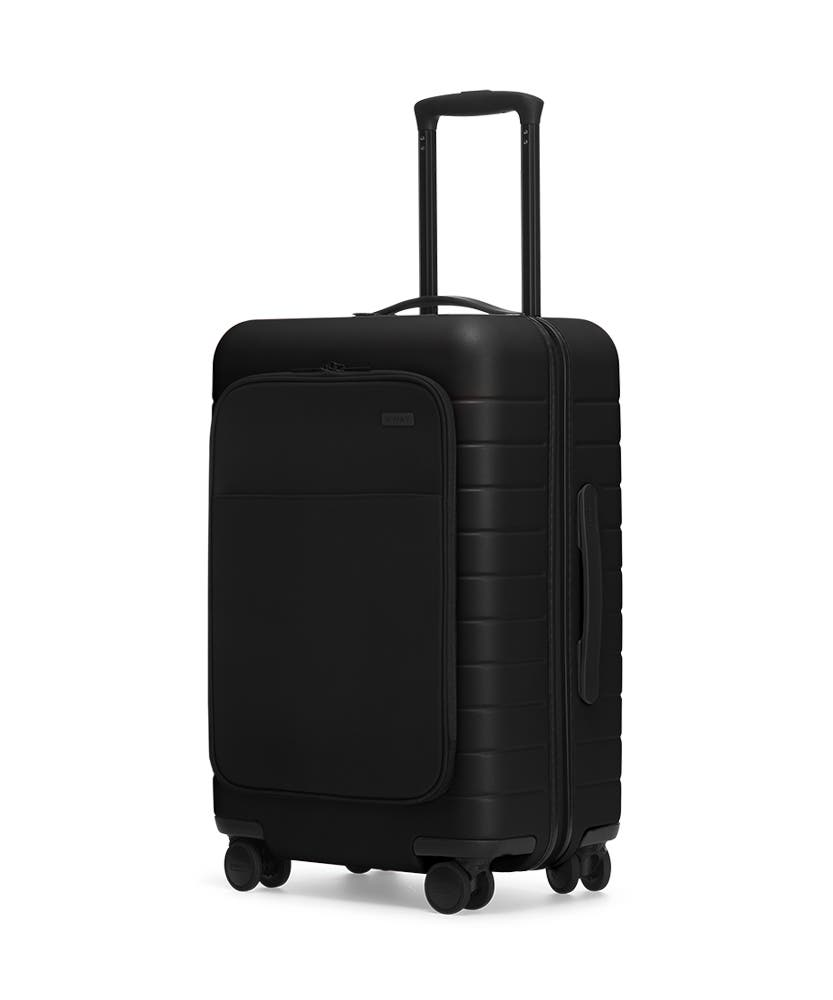 The Bigger Carry-On with Pocket in Black shown at an angle with raised telescoping handle