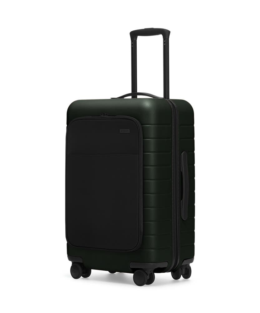 The Bigger Carry-On with Pocket in Green shown at an angle with raised telescoping handle