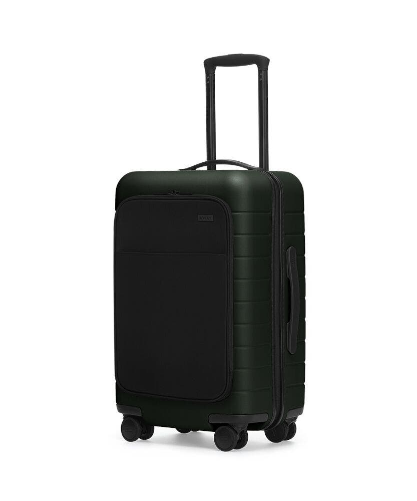 The Carry-On with Pocket in Green shown at an angle with raised telescoping handle