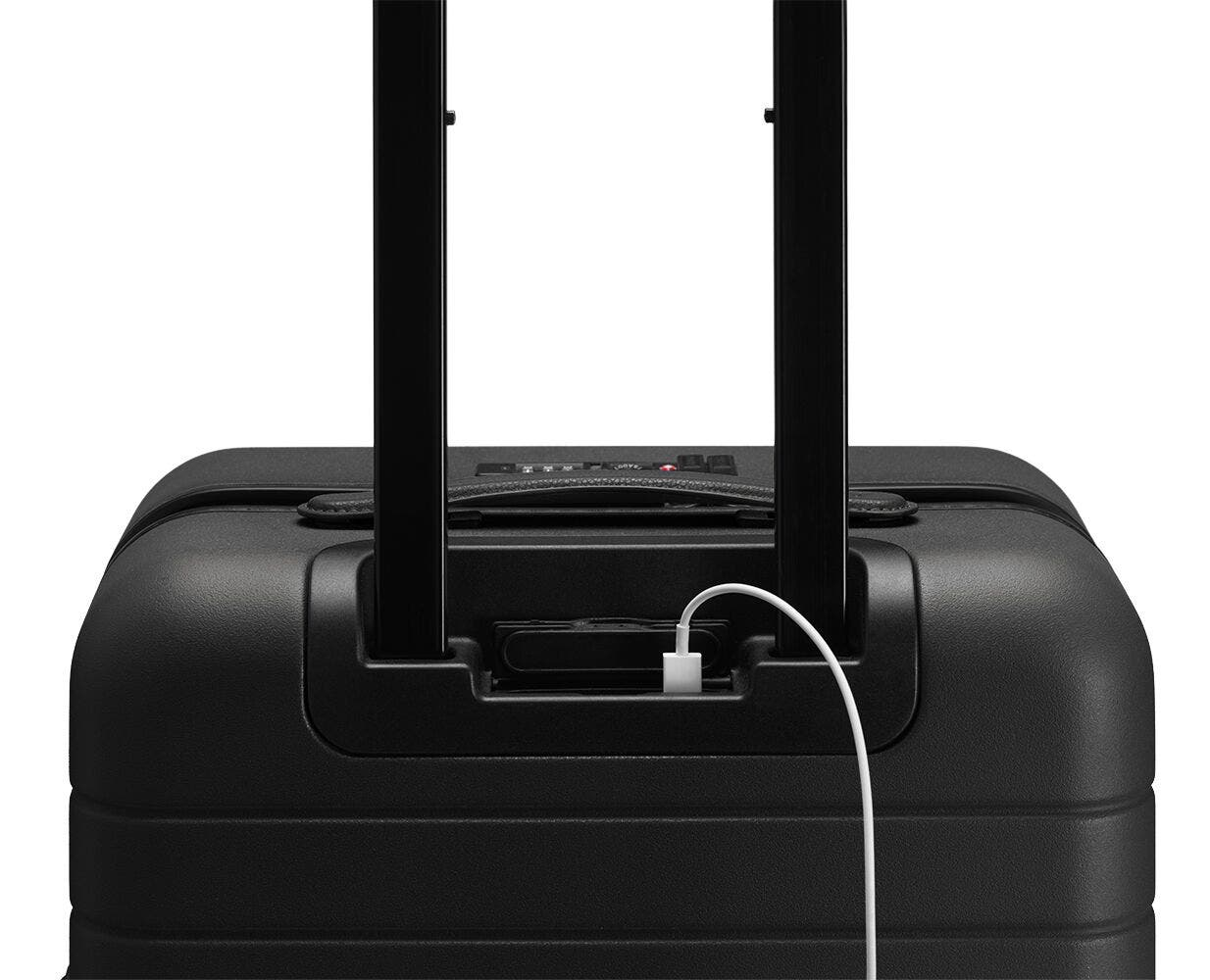 Video showing a finger pressing the battery to eject it from The Carry-On with Pocket in Black