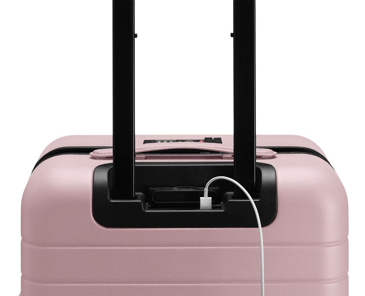 Video showing a finger pressing the battery to eject it from The Carry-On with Pocket in Blush