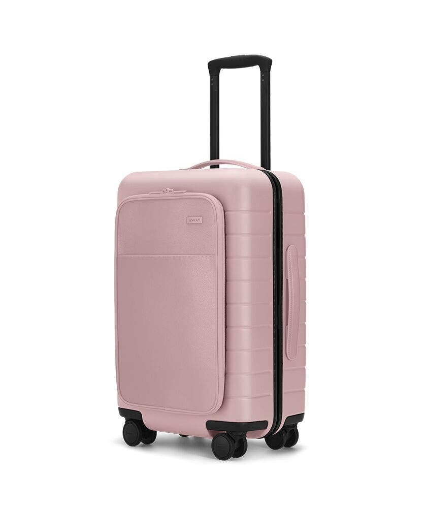 The Carry-On with Pocket in Blush shown at an angle with raised telescoping handle