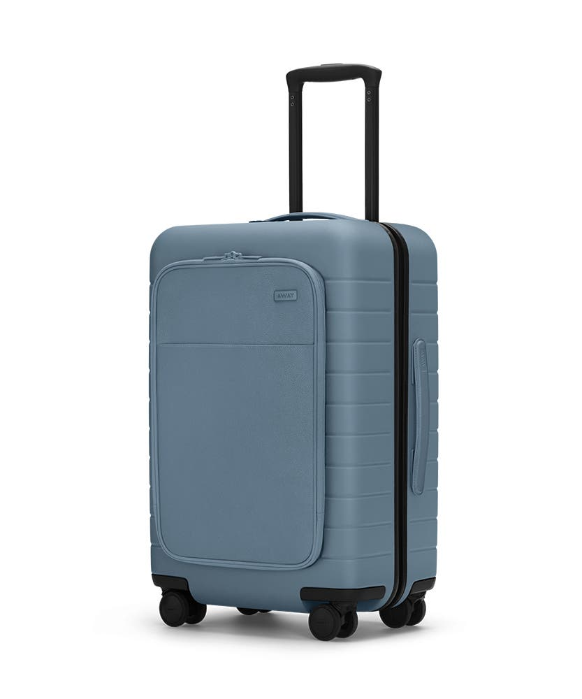 The Bigger Carry-On with Pocket in Coast shown at an angle with raised telescoping handle