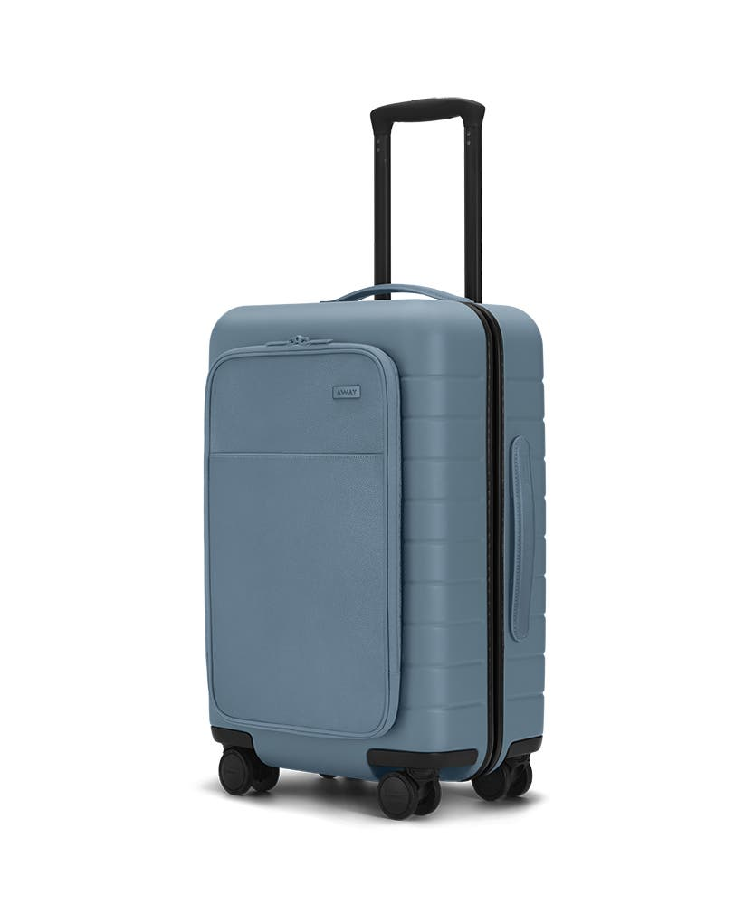 The Carry-On with Pocket in Coast shown at an angle with raised telescoping handle