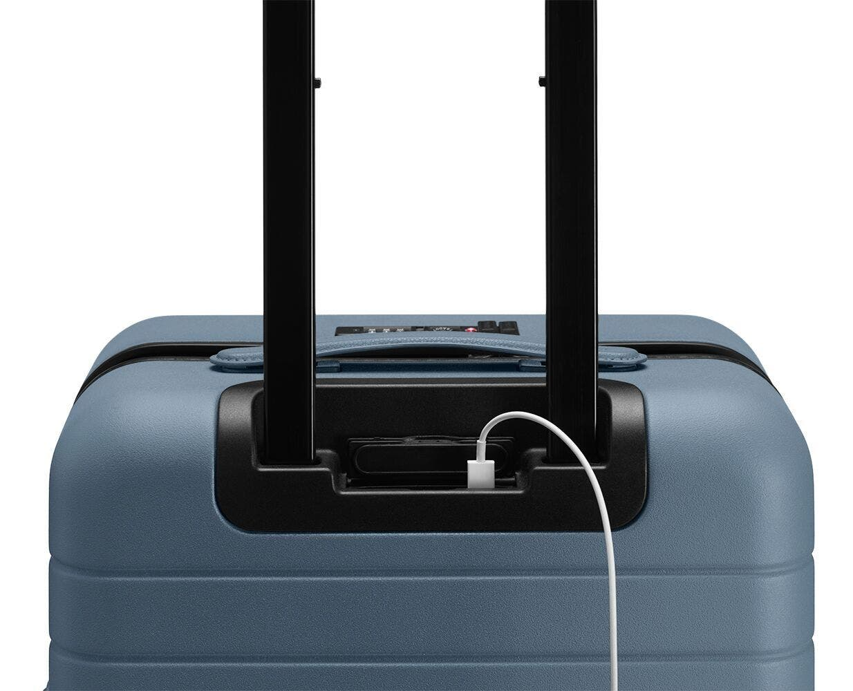 Video showing a finger pressing the battery to eject it from The Carry-On with Pocket in Coast