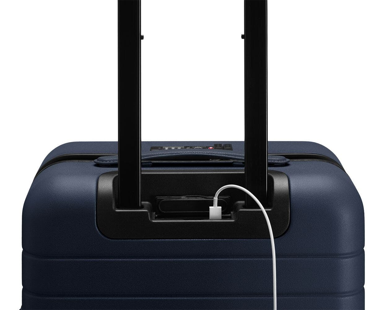 Video showing a finger pressing the battery to eject it from The Bigger Carry-On with Pocket in Navy