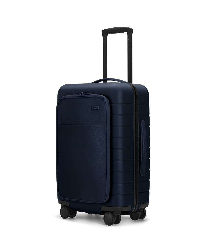 The Carry-On with Pocket in Navy shown at an angle with raised telescoping handle