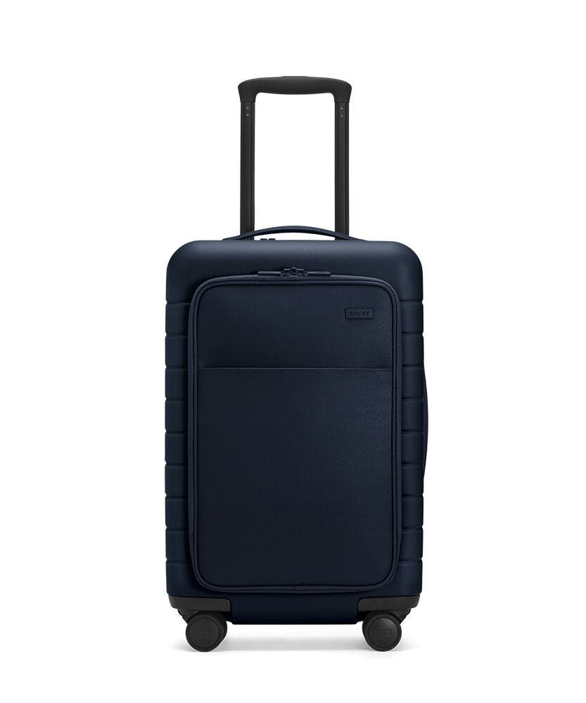 The Carry-On with Pocket in Navy shown from the front with raised telescoping handle
