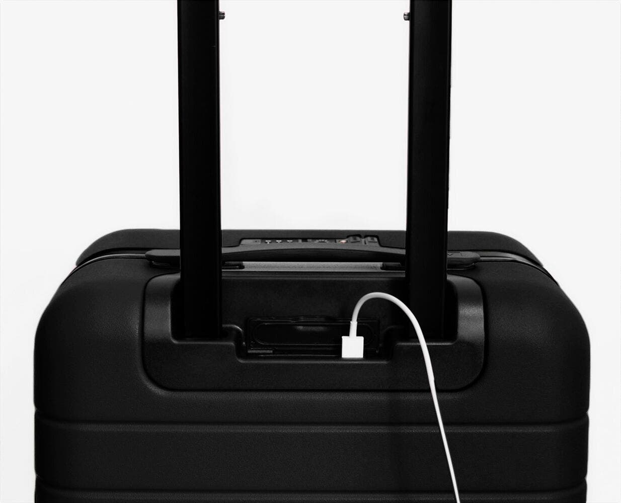 Video showing a finger pressing the battery to eject it from The Bigger Carry-On with Pocket in Black